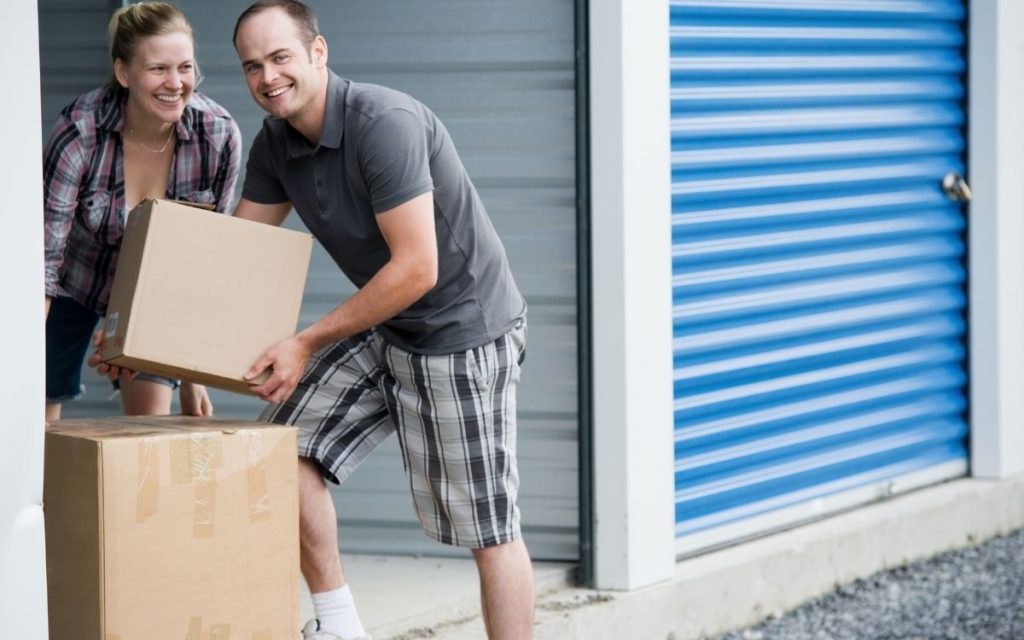 couple moving boxes of belongings into a self-storage unit